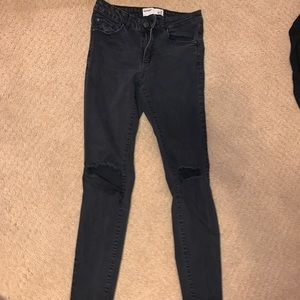 Garage size 7 black ripped jeans